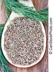 Dill Weed and Seed - A wooden spoon filled with dill seed...