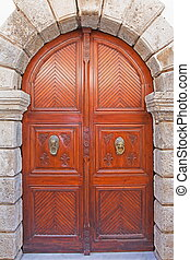 Old wooden door located on the \'island of Crete
