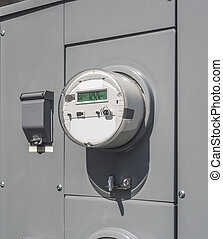 Electricity usage meter - electric meter on the side of a...