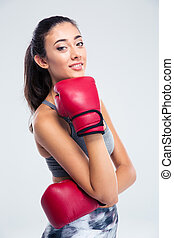 Happy beautiful girl with boxing gloves - Portrait of a...