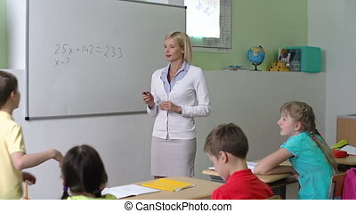 Teaching to Do Sums - Math teacher calling a schoolboy to...