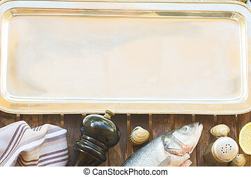 Seabass - Empty silver tray with set of fish, shellfish and...