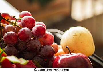 fruits at the market place - Grapes and other fruits at the...