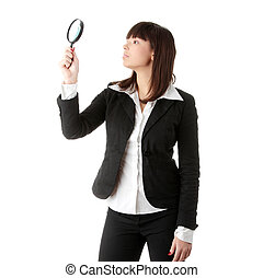 Woman looking into a magnifying glass - Young attractive...