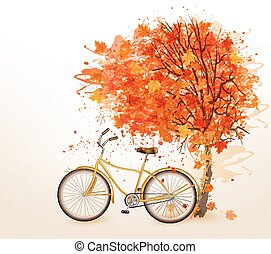 Autumn tree background with a yellow bicycle.