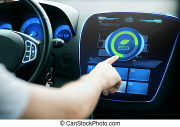 male hand setting car eco system mode on screen - transport,...