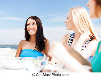 girls in cafe on the beach - summer holidays and vacation -...