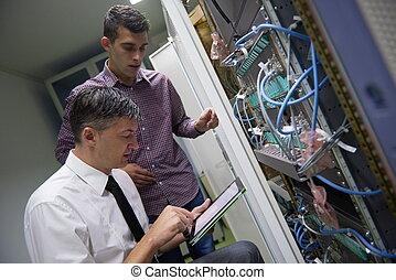 network engineers in server room - business people group...