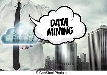 Data mining text on cloud computing theme with businessman...