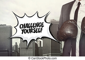 Challenge yourself text with businessman wearing boxing...