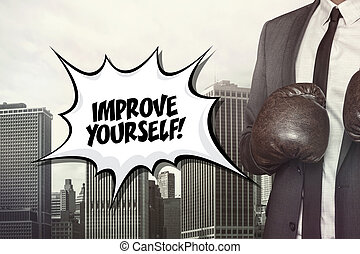Improve yourself text with businessman wearing boxing gloves...