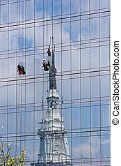 Window Washers on Building with Church Reflection - Two...