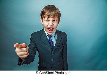 Boy screaming businessman points his finger - boy screaming...