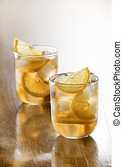 Ice tea - Glass of ice tea with lemon and ice cubes.