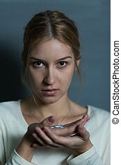 Female holding handful of pills - Photo of depressed female...