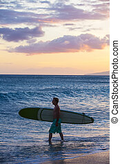 Single Man Outdoors - Single surfer carrying his surfboard...