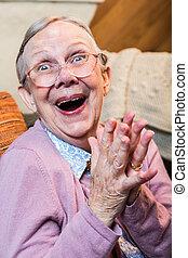 Joyful Old Woman - Joyful old woman in pink sweater with...