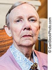Stern Elderly Lady - Stern elderly lady in pink sweater...