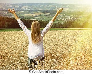 Girl among a field of wheat. Switzerland