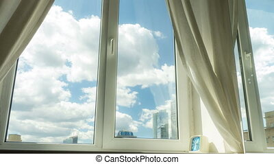 Modern residential window with clouds