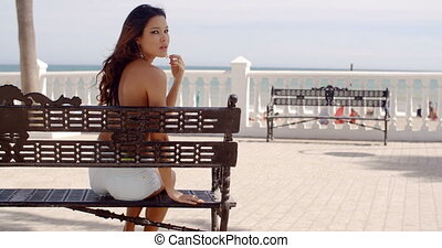 Happy young woman relaxing in the sun at the sea