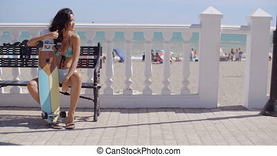 Attractive woman waiting with her skateboard - Attractive...