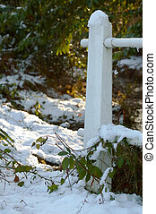 snowy woodland - snow covered post and a wintry woodland