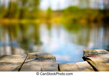 The old jetty on the still water in autumn. Selective focus