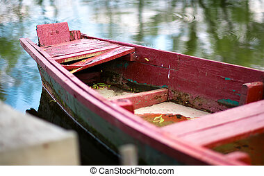 The old wooden boat on the river. Selective focus
