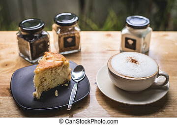 Cup of latte coffee with apple cake