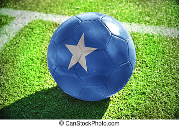 football ball with the national flag of somalia lies on the...