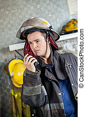 Confident Firefighter Using Walkie Talkie - Confident male...