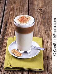 Latte macchiato - Glass of Latte macchiato with a dusting of...