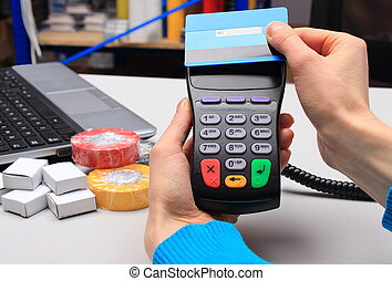 Paying with contactless credit card, NFC technology - Hand...