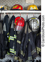 Firefighter Suits And Helmets At Fire Station - Firefighter...