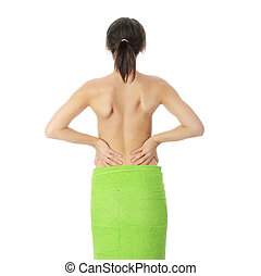 Back pain concept - Nude woman from behind. Back pain...