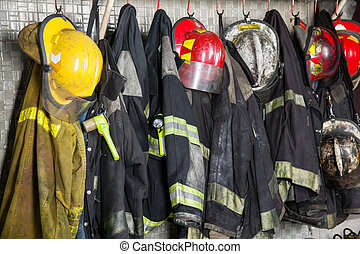 Firefighter's Gear Hanging At Fire Station - Firefighter...