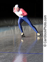 Speed Skating - Speed skater accellerating towards the...