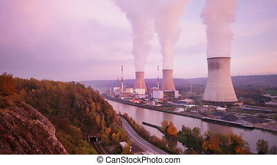 Nuclear Power Plant At River - High angle view of a large...