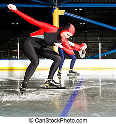 Speed skating match - The start of a womens speed skating...
