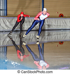 Speed Skating Race - Speed skaters during a race in an...
