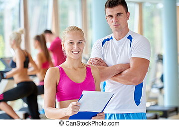 people group in fitness gym - group portrait of healthy and...