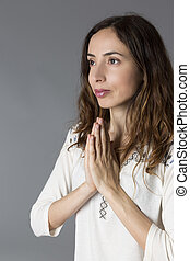 Profile view of a woman in namaste pose - Profile view of a...