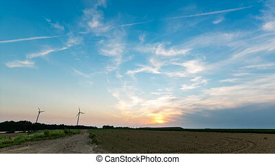 Wind Turbines And Sunset Timelapse - Time lapse sequence of...