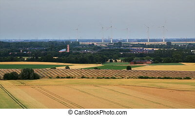 Solar And Wind Energy - High angle view over fields to a...