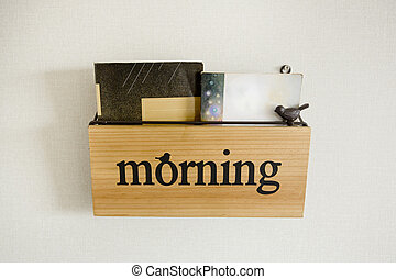 """Book shelf with wording """"Morning"""""""