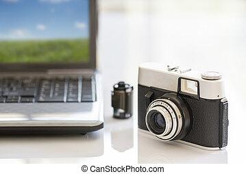 photo camera - 35mm vintage photocamera on white table near...