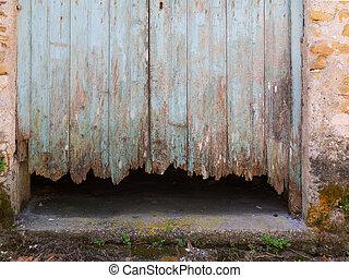 Rotten wood door - Painted rotten door made of wood