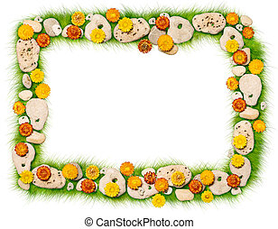 Framework from flowers and stones on a grass