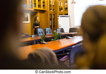 Lecture at university. - Speaker giving presentation in...